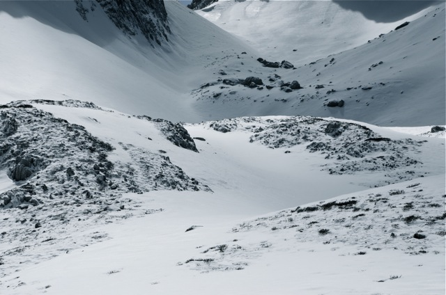 Towards the pass, over white