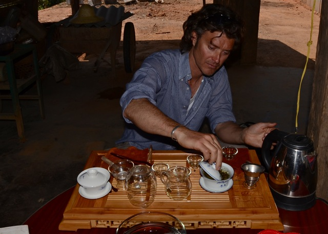 Me doing my inevitable thing serving tea in the tea mountains near Meng Song