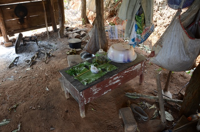 The interior of a tea harvester's hut. Food, water, fire and a rest area provide a 'home' high upon the tea mountains for the busy villagers