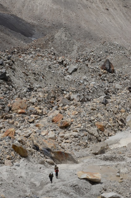 Two of our porters methodically make their way up and through a world of rock