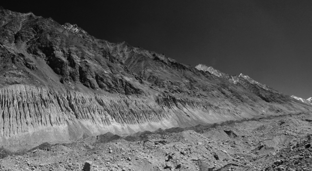 A long diagonal strip of moraine ripples like a false floor. It is such forms that make up much of what is referred to as glaciers.