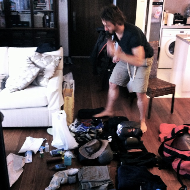 Michael in full flight skirting around kit on the floor. Gear will be sorted and resorted.