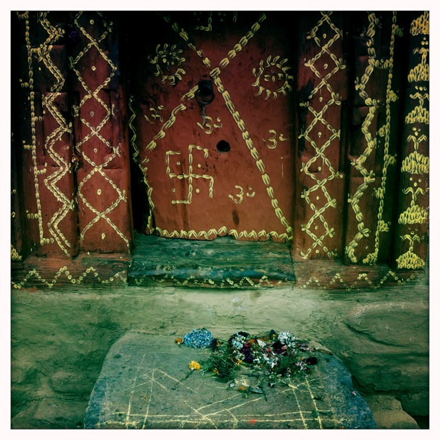 A doorway in Old Manali adorned for worship. Colour, smells, and sounds with meaning